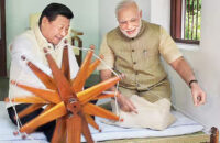 Indian Prime minister Narendra Modi and China President Xi spinning the wheel during an informal visit.